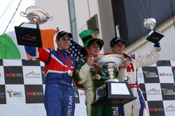 Brit Olly Jarvis and Ireland's Adam Carroll celebrate on the feature race podium