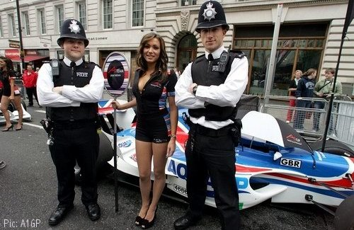 Police officers and Team GBR grid girl