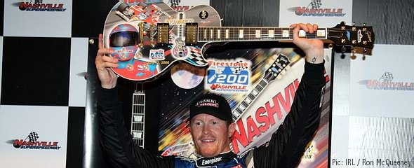 Scott Dixon with his hand-painted Gibson guitar trophy