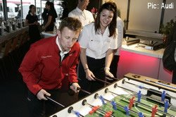 Allan McNish demonstrates Scottish football skills to Audi colleague Katherine Legge