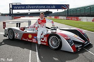 McNish poses with his race-winning Audi