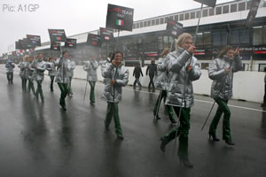 Even the grid girls suffered in the weather. Poor loves.