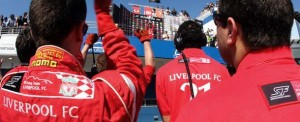 The Liverpool crew cheer their driver's victory