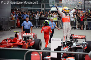 The winner and the runner-up: Hamilton celebrates, Massa departs