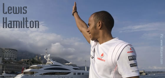 Lewis Hamilton waves to fans in Monaco Harbour