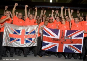 The Hamilton family, Ron Dennis, Heikki Kovalainen and the McLaren crew celebrate