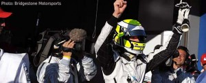 Jenson Button celebrates his first pole since Melbourne 2006
