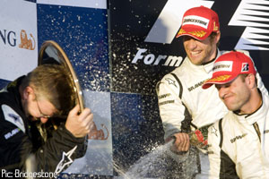 Brawn, Button and Barrichello celebrate on the podium