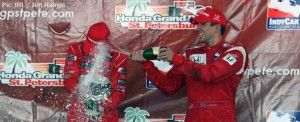 Justin Wilson drenches Ryan Briscoe on the St Pete podium