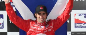 Dario Franchitti flies the flag after victory at Long Beach
