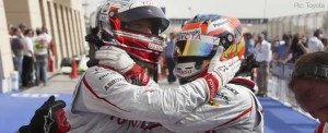 Jarno Trulli and Timo Glock celebrate their front row qualifying