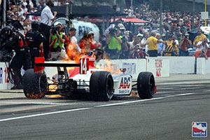 Meira on fire in Foyt pitbox