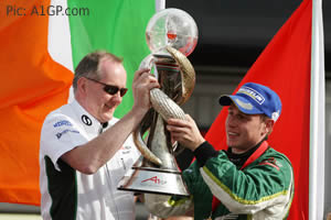 Irish boss Mark Gallagher, driver Adam Carroll and a very big trophy