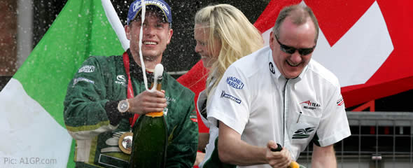 Adam Carroll and Mark Gallagher celebrate winning two races and a championship in one day