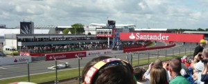 Jenson Button hits the start/finish straight in practice