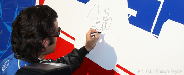 Dario Franchitti signs his autograph at the Texas Motor Speedway