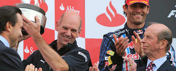 Red Bull designer Adrian Newey accepts the constructors' trophy at Silverstone