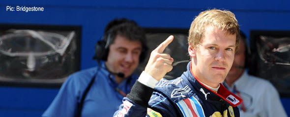 Sebastian Vettel celebrates earning pole position in Turkey