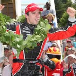 Justin Wilson celebrates his victory at the Glen