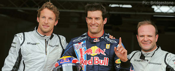 Mark Webber celebrates earning pole