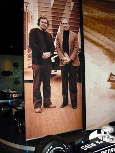 Patrick Head (with holes in shoes) and Frank Williams