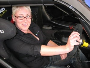 Image of YRC founder Hannah James behind the wheel of a car