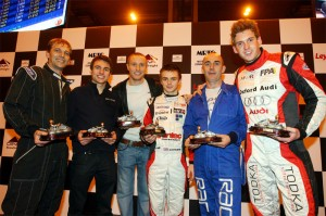 Paul Rees (right) and the rest of the Loose Cannons celebrate a karting victory