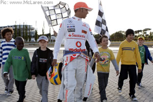 Lewis Hamilton and schoolchildren promote the launch of his M&S clothing range