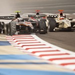 Will Bratt (black car) and Max Chilton (white car) battle it out in Bahrain