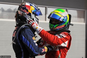 Felipe Massa congratulates Sebastian Vettel on securing the first pole position of the season