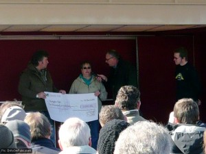 Yvonne Bennett of the Donington Park Racing Association Club presents a cheque to Kevin Wheatcroft, while event organiser Lee Coombs watches