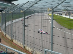 The Formula Renault UK field enters turn one at Rockingham
