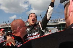 Helio Castroneves celebrates his fourth pole position