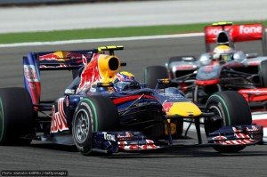 Mark Webber holds off Lewis Hamilton in the early stages of the race