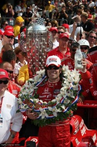 The Borg-Warner trophy towers over Franchitti