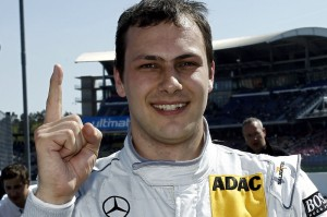 Gary Paffett celebrates his pole position at the 2010 DTM season opener at Hockenheim - a race he went on to win.
