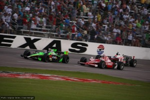 Danica Patrick battles Scott Dixon and Ryan Briscoe