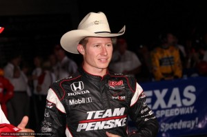 Ryan Briscoe dons the traditional winner's hat