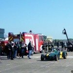 Fernandes and other members of the Team Lotus family congratulate Kovalainen on his display
