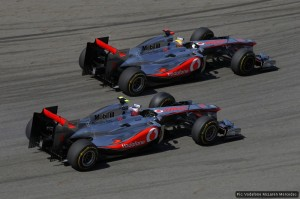 Lewis Hamilton and Jenson Button race each other