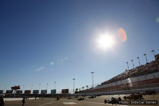 The pitiless Nevada sun beats down as spectators and race crews watch 19 IndyCars salute Dan Wheldon