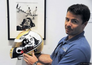 Oriol Servia shows off the inspiration for his race helmet